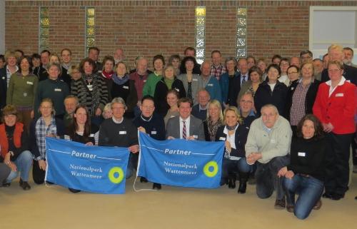 Die Nationalpark-Partner beim Jahrestreffen 2013 mit Staatssekretär Dr. Ulf Kämpfer (1. Reihe, 5. von links) (Quelle: Hecker / LKN-SH)